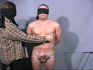 Blindfolded gay guys go at each others big cock