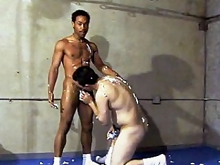 This scorching hot homo interracial sex takes place in a gym, where...