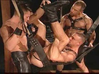 Gay leather guys having intensive sex