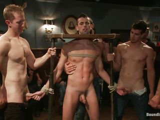 This chab is bound and drilled in front of other men. This chab likes being bound up and humiliated, that's why he rubs those dongs and sucks 10-Pounder with so much joy while having his neck secured in that device. Those fellows are funny, look at that one hanging on a rope and fucking his gorgeous mouth. What do you think about these sexy wild boys?
