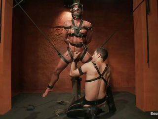 Fastened with leather belts, hanging and having medical clamps on his balls and body this guy enjoys his position and of course the feeling of being permeated deep by a hard dildo that goes in his ass. He acquires a harsh treatment and needs to obey cuz his gay executor will not spare him until his job is done