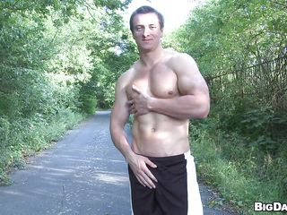 In a walk way throughout a park-like forest, one hawt hot muscled dude is doing a disrobe show to amuse the camera man. This guy got such a nice arse that anyone would love to shove his in it. However, another hawt dawg join in and wearing a strip-pantie he pole dancing around a tree!